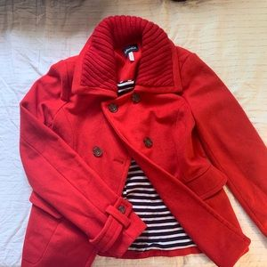 bulky red peacoat